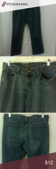 Old Navy Blue Jeans The Flirt 10 Short Stretch This is a pair of misses jeans by Old Navy in a size 10 short Cotton polyester spandex fabric Bootcut leg 5 pocket style Med blue in color In very good used condition Old Navy Jeans Boot Cut