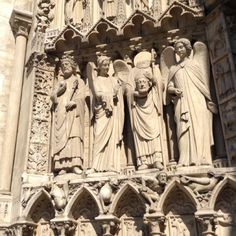 Notre-Dame de Paris, Paris, France — by Sandra Ruehlow. Details of Notre Dame Cathedral including St. Denis who is still carrying his head.