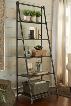 Designed to emulate black iron pipe often used in commercial construction, Pier 1's Acero Shelf combines space-saving functionality with contemporary flair. Five shelves taper from deep to narrow, giving a ladder-like illusion.