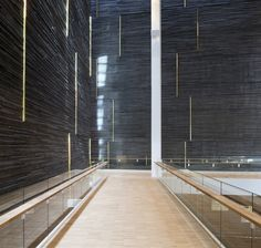 wood rail on glass baluser + large scale application of serpentina tile/ stone + long vertical strips of lighting  ~via tumblr -  88 Floors - No Elevators, City in the City, Malmo- Schmidt Hammer Lassen...