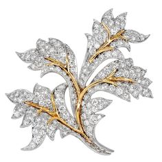 Platinum and 18 karat yellow gold leaf motif estate pin set with approximately 8.50 carats total weight of round brilliant cut diamonds, signed Schlumberger.