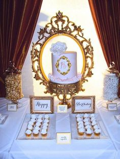 Gold and white cupcake and cake display