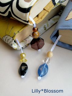 beaded bookmarks added to my book bags make sure you never lose your place... easy to make...http://www.etsy.com/listing/53144145/pdf-sewing-pattern-book-bag-paperback