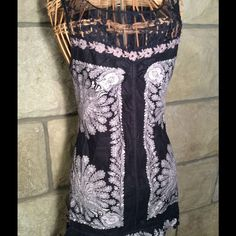 Free People tunic/dress Lovely lace bodice meets floral embroidery with sequin and metal leaf detailing.  Side zip.  Ruffled hem. Free People Dresses Mini