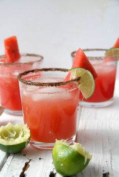 Smoky Watermelon-Jalapeno Margarita - 1 jalapeno chile pepper, 2 oz tequila, 1 oz freshly squeezed lime juice, 1 oz watermelon puree, 3/4 oz agave nectar/syrup, Hickory smoked salt for rimming the glass