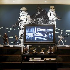 """This original wallmural features the famous characters from the Star Wars movies. It's the perfect gift to any Star Wars fan and a must-have of every man's cave. This wall mural is reusable, removable and super easy to install. Just peel it off, stick wherever you want and reposition whenever and wherever you like. It won't leave any sticky residue, rip or wrinkle. And it's eco-friendly too! Available sizes: - 75"""" x 50"""" - 100"""" x 70"""" - 145"""" x100"""" Please allow 6-8 business days for…"""