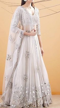 Call/WhatsApp : Unique and thoughtful craftsmanship makes our outfit different and even reserves its value for the future. Lehenga Choli Designs, Designer Party Wear Dresses, Indian Designer Outfits, Indian Lehenga, Lehenga Indien, Desi Wedding Dresses, Gown Wedding, Lace Wedding, Indian Bridal Outfits