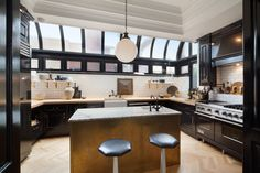 Black and white chef's kitchen with skylights in this Greenwich Village penthouse [1600 x1067]