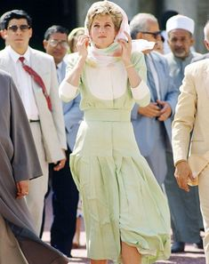 May 13, 1992 Princess Diana coveres her blonde hair appropriately with a floral silk scarf during a tour at Al Azhar Mosque in Cairo, Egypt