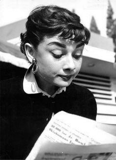 Hepburn reads.  theniftyfifties:    Candid Audrey Hepburn, 1953.