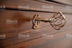 Ancient furniture lock, decorated key. royalty-free stock photo