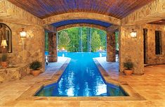 Uniting indoor and outdoor spaces, this pool provides a enclosed area perfect for swimming laps or simply admiring the beautiful stonework. Blue Haven Pools & Spas www. Luxury Swimming Pools, Luxury Pools, Indoor Swimming Pools, Dream Pools, Lap Pools, Indoor Outdoor Pools, Lap Swimming, Blue Haven Pools, Roman Pool