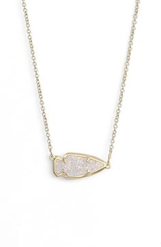 obsessing over this striking pendant necklace from kendra scott thats anchored with an arrowhead shaped