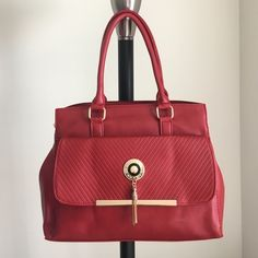 """red riches Handbag   """"Red Riches"""" BrAnD nEw HaNdBag~ ONLY 1 of this color and style available! -Brand: sold by Cali&Karma (retails for $95) -Color: red with gold hardware -Dimensions: 15"""" length, 11"""" height, 4.5"""" width -Options: adjustable crossbody strap -Details: front 'envelope' pocket, back pocket, interior pocket, two interior pouches, **varied lighting may vary bag's appearance -Other: no trades or holds/cannot be restocked/open to •o f f e r s• using offer button/ can provide add'l…"""