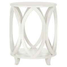 Found it at Wayfair.com - Janika End Table in Off White.  I love this, but I would have to paint it black.