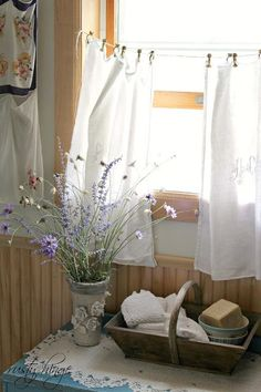 Simple, white, cotton panels hanging at the window, clipped onto string.