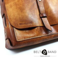 Sneak peek of our very first handbag! Weaver style leather bag featuring fully hand stitched front pockets. Dimensions - 27cm x 19cm x 8cm. Made to order. Colour options ranging from tan brown chocolate red black navy or natural vegtan. DM for pricing and further details.  #beltandband #handstained #handbagsofinstagram #handstitched #bespoke #bespokeleather #handmade #handmadeinsa #leatherwork #leather #leatherhandbag #customorder #blog #madeincapetown Black And Navy, Red Black, Leather Handbags, Leather Bag, Leather Working, Hand Stitching, Bespoke, Satchel, Belt