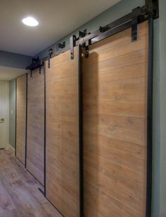 Barn doors replaced dated accordion doors in this condo for a modern and fresh way to hide storage areas.