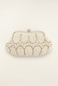 """Bursting with pearls and crystal rhinestones, this lustrous clutch will instantly add glamour to your look!  Expressions NYC clutch is embellished with a luxe mix of dazzling pearls and crystal rhinestones.  Clutch features a solid satin back and embellished clasp closure.  Length: 8.5"""", Height: 4.25"""" Complete with a silver chain link strap. Chain length: 42"""" Available in Ivory.  Imported."""