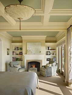 - What a lovely master bedroom. Ceiling treatment, color, fire place, big windows and access to the back yard . . . AWESOME.