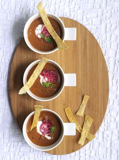 Smoky spiced black bean soup with pickled lime onions