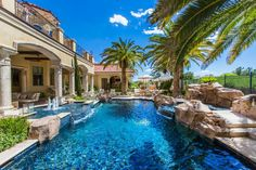 A heavenly blue pool is the centerpiece for what can be described as a backyard paradise.