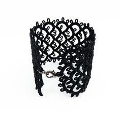 Black lace cuff bracelet.  You could do this with any ribbon or color.   I didn't look at the site but I think you would use starch to stiffen it.