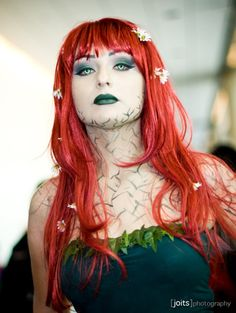 Poison Ivy cosplay at San Diego Comic-Con 2011. Photo by Joits. (Source)  Love the chamomile looking flowers and the eyes