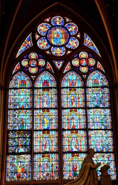 Stained Glass - Notre Dame de Paris. he cathedral treasury houses a reliquary with the purported Crown of Thorns. Notre Dame de Paris is widely considered one of the finest examples of French Gothic architecture in France and in Europe, and the naturalism of its sculptures and stained glass are in contrast with earlier Romanesque architecture. The first period of construction from 1163 into 1240s coincided with the musical experiments of the Notre Dame school.