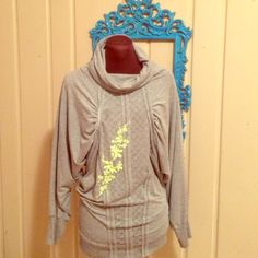 Colcci grey tunic with neon embroidery:) Grey stretch jersey tunic top with neon embroidery on front and peep hole on back. Very cool unusual design. Super comport able and interesting! Colcci Tops Tunics