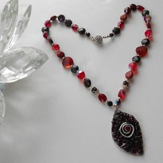 Muladhara Chakra Necklace , Necklaces | $297 Garnet, Red Jasper and Red Tiger's Eye blend together with sparkly Swarovksi crystals for a modern day Goddess empowerment tool.