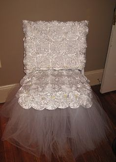 Kind of cute how they have a chair decorated for the bride to open gifts. Not sure about exactly this one...