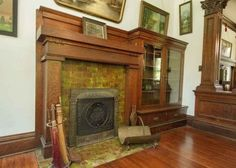 Historic 1910 home in the Broadway District. Fireplace with attached bookcase.