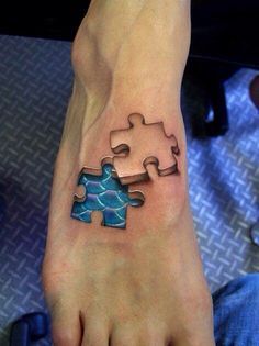Puzzle piece Tattoo with mermaid scales underneath on top of foot
