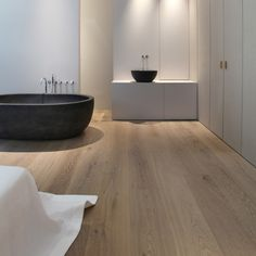 | BATHROOMS | Modern structures by Lens°Ass architecten - the next time someone says to me that I can't do wood in the bathroom ... I will send them them this image ... lovely yet simple detailing with beautiful extra wide wood plank floors - adore #bathrooms #wood