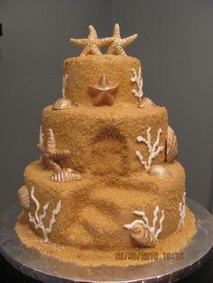 love this sandcastle cake! www.barefootbrideoc.com