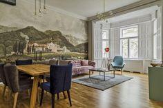 Hangulatos mediterrán falikép és gyönyörű bársony ülőalkalmatosságok teszik ellenállhatatlanná ennek a 13. kerületi lakásnak a nappaliját. Legszívesebben minden szabadidőnket egy ilyen nappaliban töltenénk.  Találd meg te is álmaid otthonát a www.livlia.com ingatlanportálon.