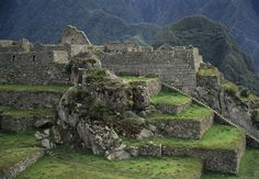 Inca stone terraces and staircases at Machu Picchu.