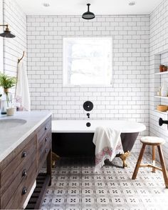 This is -rustic modern farmhouse bathroom with white subway tile, black claw foot tub, patterned tile floor and Restoration Hardware Vanity. Mindy Gayer Design See more favorite spaces at Beckiowens.com!!