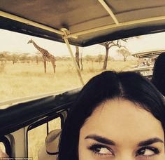 Full of wonder: Vanessa snapped this selfie featuring a grazing giraffe over the weekend, ...
