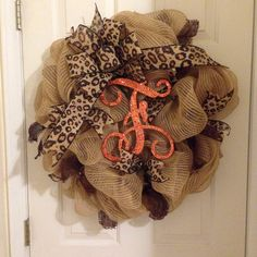 A personal favorite from my Etsy shop https://www.etsy.com/listing/229176618/leopard-glitter-letter-deco-mesh-wreath