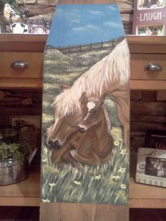 old wood ironing board that I painted with a mare and foal...By Julie Baker-Lowden