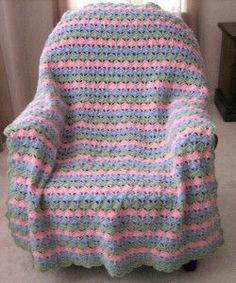 Rows of pink, green, and blue seashells make up this lovely crochet afghan. The She Sells Seashells Afghan is an easy 4-row pattern featuring the shell stitch. If you are crazy for Shells, this free pattern is for you!