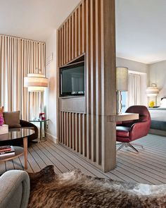 Thompson Chicago, a Thompson Hotel Chicago, Illinois indoor room window floor sofa Living wall ceiling property living room chair furniture home bed real estate interior design hardwood condominium hotel Suite Bedroom decorated flooring apartment wood flooring nice rug Modern flat