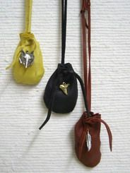 """Native American Cherokee Made Buckskin Medicine Bags - These wonderful small medicine bags are made of the finest buckskin by Cherokee artifact master Wetfoot. The leather strap is adjustable and drops approximately 14 inches. The bag is finished with a metal decoration. The leather color and the decoration will vary. Certificate of Authenticity included. Dimensions: 3"""" long x 2"""" wide. $27.95"""
