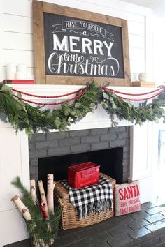 Love this farmhouse Christmas fireplace and mantle. Love the shiplap. The garland on the mantle is gorgeous. Love the pillows and birch wood. So festive and cozy! #fireplace #Christmas #garland #mantle