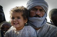 Hamadinou ould Hami, 32, with his 2 year old daughter Touha. Hamadinou arrived to Mbera refugee camp in #Mauritania in February 2013 with his family. They fled violence in their hometown of Gundam in the Timbuktu region in Mali.  UNHCR / B. Malum / February 2013
