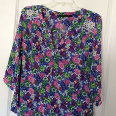 "Fun 2 Fun Floral Tunic Top Great spring tunic top with an abundance of colors. White crochet detailing at collar. Polyester. Very versatile and feminine! Bust {38"".} Length {27"" at back.} Never worn. Extra button attached. ModCloth Tops Tunics"