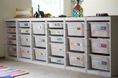 playroom storage...maybe add a curtain to top
