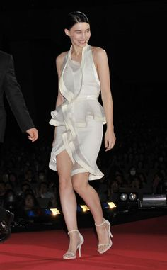 With her penchant for dreamy dresses to offset her dark charm, Rooney Mara opted for a Givenchy ruffled number from the Spring/Summer 2012 collection for the Tokyo premiere of The Girl With The Dragon Tattoo. The dress, featuring white satin details to catch the light, was a significant choice just days after the Givenchy haute couture Spring/Summer 2012 presentation in Paris.